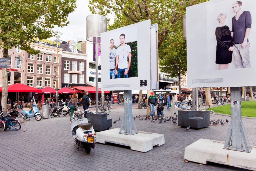 Exhibition winners Pride Photo Award 2012 at Rembrandtplein, Amsterdam. Middle; the project I Am Gay and Muslim by Chris Belloni and Bram Belloni (Photography). Right; project Moms and gays by Diederick Habermehl. Amsterdam, September - November 2012.
